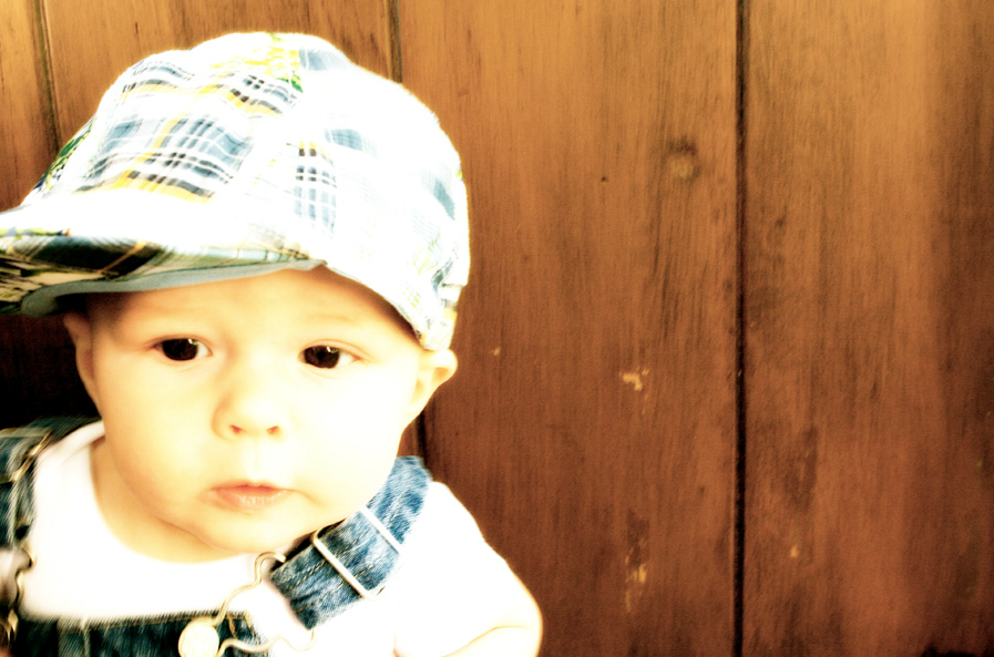 Baby with a hat and overalls